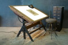 Oak Iron Drafting Table Lit via Vintage Industrial & Mid-Century Furnishings (one of the most trafficked images on our site) Modern Drafting Tables, Vintage Drafting Table, Industrial Drafting Tables, Industrial Stool, Drawing Desk, Drawing Tables, Drawing Board, Coin Couture, Style Loft