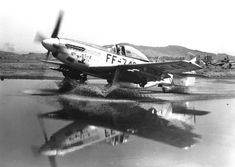 US Air Force F-51 Mustang fighter taxiing through a puddle, Korea, circa early 1950s
