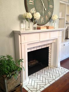 Love the tiling below the fireplace