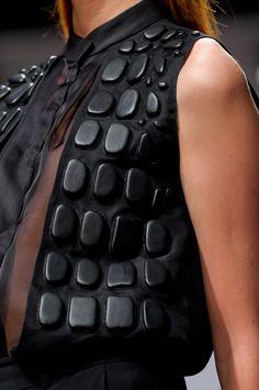 Black blouse with leather pebble textures - 3D appliqué; artful fashion details // Krizia