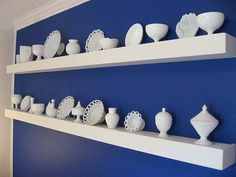 beautiful way to display milk glass - I shoudl look through my collection!