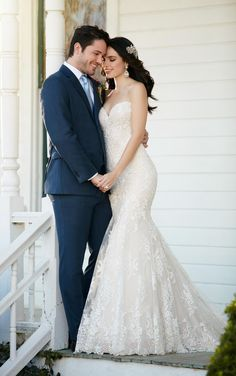 This fit and flare wedding gown with a strapless, sweetheart bodice from Martina Liana proves to be a breath of fresh air. It features vintage-style lace on tulle over matte-side Lustre satin and boasts a scalloped lace hem. This back zips up under fabric buttons.