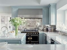 Jennifer Lopez - There are all these tones of gray, and we played with that—using a bit more of a gray-taupe here, a bit more of a gray-blue there, says interior designer Michelle Workman. Its almost like a black-and-white film from the forties. Kitchen Island With Stove, Farmhouse Kitchen Cabinets, Kitchen Cabinet Colors, Kitchen Paint, Kitchen Decor, Kitchen Ideas, Kitchen Inspiration, Farmhouse Decor, Ikea Kitchen