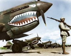 """A Chinese Nationalist soldier guards a row of Curtiss P-40 'Warhawks' flown by the 'Flying Tigers' of the American Volunteer Group (AVG) July, 1942. (Nb: The airrcaft No. """"106"""" is a P-40E, piloted by Maj. John Emil Petach, who was killed on the 10th of July 1942, a few days after this photo was taken. He flew as a Flight leader with the 2nd """"Panda Bear"""" Squadron (later 75th Fighter Squadron, 23rd Fighter Group) and had accumulated 5.25 kills. The Curtiss P-40 made its debut in China with…"""