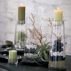 So zen! Love the natural colors of the candles and earthy elements like the branches and rocks.