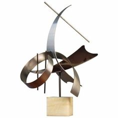 "CURTIS JERE Sculpture  Large Scale Abstract Modern Stainless Steel Table Sculpture by CURTIS JERE, Signed/Dated 1979.  Mounted on Onyx Plinth.  31"" Tall x 21"" at Widest Point x 16"" Deep.  $2100     Contact us via email at bougainvillealane@gmail.com to order.  Visit our galleries located at Adjectives Market, Winter Park Village, Winter Park Florida and Altamonte Springs, FL   SOLD We have other Curtis Jere pieces available in our gallery located at Adjectives Market, Altamonte Springs, FL"