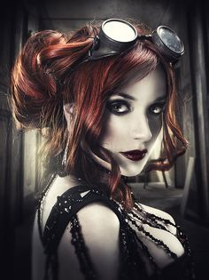 Steampunk Aviator beauty shot with gorgeous red hair with deep merlot tones framing her face.