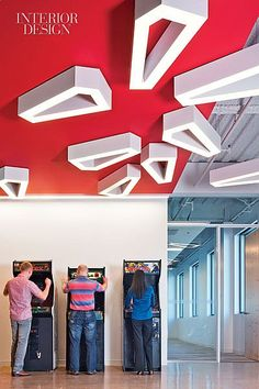 On the Phone: Gensler Designs Nokia's Slick Silicon Valley HQ | In the arcade, employees rack up points beneath ceiling fixtures by 5+1AA. #design #interiordesign #interiordesignmagazine #office #architecture #decor @gHospitality