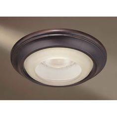 Bronze cover for recessed light fixture is easy on the eyes.