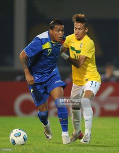 Ecuadorean midfielder Michael Arroyo (L) vies for the ball with Brazilian forward Neymar during a 2011 Copa America Group B first round football match held at the Mario Kempes stadium in Cordoba, 770 Km northwest of Buenos Aires, on July 13, 2011.
