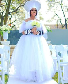 """How beautiful is incorporating Zulu Hat """"Isicholo"""" and beaded bangles in her white wedding gown. White Wedding Gowns, Top Wedding Dresses, Elegant Wedding Dress, African Print Dresses, African Fashion Dresses, African Dress, South African Wedding Dress, African Wedding Attire, South African Traditional Dresses"""