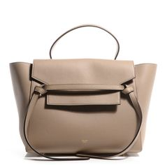 This is an authentic CELINE Drummed Calfskin Mini Belt Bag in Dune.  This chic tote is crafted of rich smooth calfskin leather with a structured and spacious silhouette.  The bag features a leather strap top handle and an optional shoulder strap with brass clasps.  The facing flap opens from an adjustable strap to a suede interior with room for your daily essentials or as a stylish travel companion with the classic innovation of Celine!