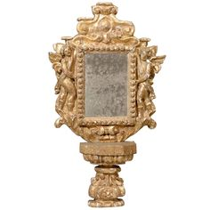 Small Size Italian Gilded Mirror on its Pedestal | From a unique collection of antique and modern wall mirrors at https://www.1stdibs.com/furniture/mirrors/wall-mirrors/