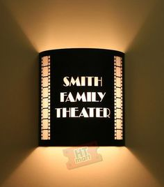 Customized Theater Wall Sconce with Vertical Filmstrips - Would love to have these in the theater room
