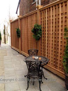 Cedar privacy fence with trelliswork