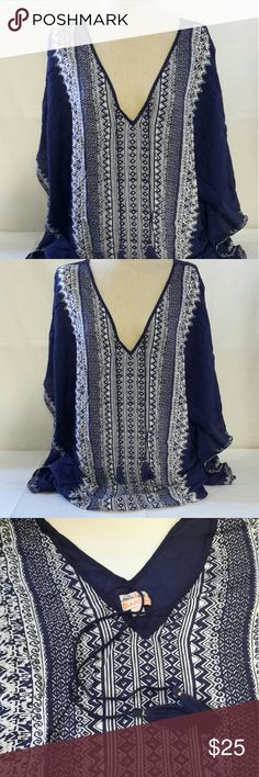 Stella & Dot Indigo Tunic New without tags. Will come folded and wrinkled.   Stella & Dot Tunic Caftan Geometric Indigo & White Blouse Beach Cover Medium   These are 100% Genuine Stella & Dot Products!  Flowing navy and white caftan will add glam to your look from warm beach days to summer nights out. Double V with neck tie. Unique Stella & Dot designed print. Fabrication: 100% Rayon Care Instructions: Hand Wash Cold. Use only non-chlorine bleach when needed. Lay Flat to dry. Low Iron as…
