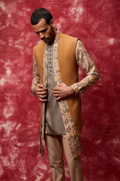 Contrast Long Draped Shawl style Nehru Jacket with Short Length Kurta along with Trousers!  #EhsaasByQbik, the collection is ideal for cheery day functions and intimate weddings. Get your Amazing Qbik menswear piece from, now! Contact us now 07931 999111 or email us at contact@bibilondon.com to book your Consultation, for bespoke and customized services by our experienced team! #menswear#IndianCouture #bibilondon #qbik#bibildn #indiancouture #indiansuit #qbikatbibilondon #nehrujacket #kurta Indian Groom, Indian Suits, Coat Styles, Waist Coat, Wedding Sherwani, Nehru Jackets, Men Fashion, Fashion Trends, Indian Couture