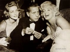 Lauren Bacall, Humphrey Bogart and a very glamorous Marilyn Monroe at the premiere of 'How to Marry a Millionaire'; Bogart was taking a glimpse at Marilyn';s decolletage even though she was laughing and smiling for the camera. Hollywood Stars, Old Hollywood, Golden Age Of Hollywood, Hollywood Glamour, Classic Hollywood, Hollywood Photo, Fotos Marilyn Monroe, Marilyn Monroe Poster, Marylin Monroe