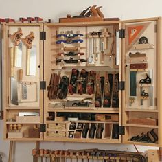 """A Cabinet for Hand Tools.  Fine Woodworking.  Pretty close to what I want, but with more drawers and less plane """"cubbies"""" along the bottom."""