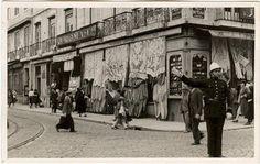 Lisbon, 1940. Signalman in Figueira Square. Fabric shop on street corner of Rua da Betesga with Rua dos Fanqueiros.