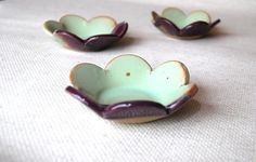 Flower  dish in eggplant and mint  handmade pottery by claylicious, $27.00  Not sure what I'd use these for, but I sure love 'em!