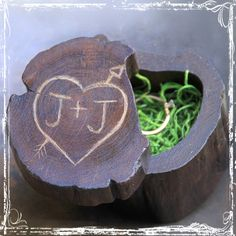 A rustic and lovely alternative to the traditional ring bearers pillow. Your initials will be hand carved in an old fashioned, rustic, style to imitate the look of carving your initials in a tree, using a pocket knife. Makes a lovely keepsake!~A special ring deserves a special box.The lid swivels to open, holding the rings securely, and opening easily. Made from a single piece of wood, so the top and bottom match-up perfectly. Each box is completely unique, just as nature in...