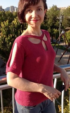 """Free Knitting Pattern for Tempesta Top - Short sleeved pullover with flower petal cut outs in the front and cold shoulder sleeves. Sizes 35 (39, 43, 47, 51)"""" Bust. Designed by Kristin Omdahl. Pictured project byCarmen73. Sport weight yarn."""