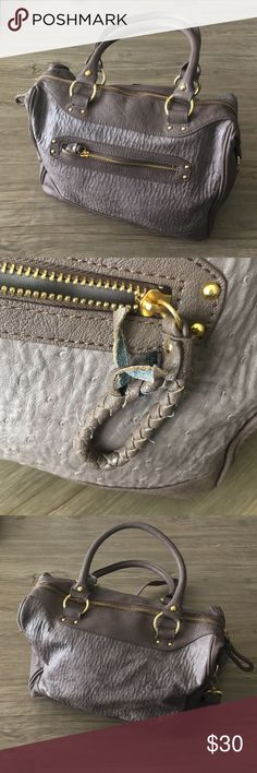 Steve Madden Taupe & Gold Satchel This is an amazing go-to purse since it's very spacious and has an extra strap to wear over the shoulder or as a crossbody. Please note the wear on small zipper as the woven leather has started to come undone. Otherwise still in good condition! ✨ Steve Madden Bags Satchels
