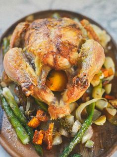 Easy Dinner Recipe: Viking Chicken — Recipes from The Kitchn. So fun!! Will be a great autumn dish. The veggies on top crisp up a bit more, so it's good to put things like beets & Brussels sprouts on top.