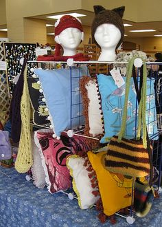 Bayport Craft Fair booth by telaine, via Flickr. Used wire cubbies to organize and add height.