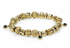 Nothing says luxurious like this stunning 14k gold bracelet with pops of mysterious black