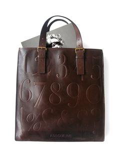 Assouline bag by Cole Haan w/ Didot font. I've been lusting after this bag for ages!!!