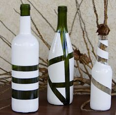 Decorating bottles with tape and paint. Peel off the tape while the paint is till fresh so it wont crack.
