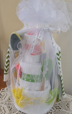 Wedding Shower Towel Cake.  Here's the link I used for directions on how to put it together:http://www.youtube.com/watch?v=bdgIN0KrQFg Then added ribbon of the bride's colors for her wedding, and added some utensils and dish towels, etc, that I found also in her colors.  Wrapped it all up with 2 yards of tulle.
