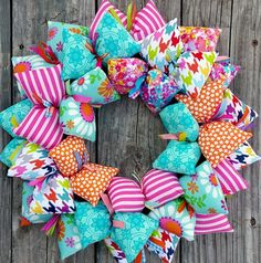 There is something to be said for a bright and vibrant wreath welcoming you and your guests into your home.  This is that wreath!  Spring is coming, and the colorful fabrics and fun patterns in this h