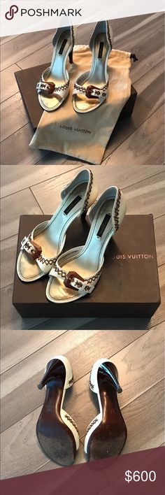 Authentic Louis Vuitton Heels Authentic Louis Vuitton Ivory and Brown heels. Size 37. Wooden heels.  Comes with dust bag and box. Gently used - show minor signs of wear on the heels. See pictures. Extra heel tips were included at the time of purchase.  Feel free to ask me for more photos. Louis Vuitton Shoes Heels