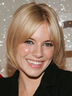 Curtain bangs: The curtain (or Bardot bangs, if a little shorter) are one of my favourites because they're so versatile on a variety of face shapes. Sienna Miller is probably the modern-day queen of this bang style, which parts in the centre and frames the face on either side. Since ovals are in balance, you don't need to worry about where the bangs end on the face. Super-cute!