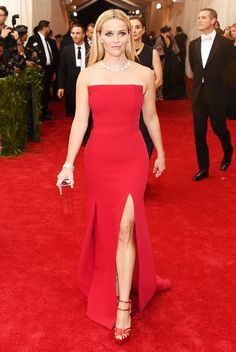 Reese Witherspoon in a stunning strapless red gown and sleek hair at the 2015 Met Gala