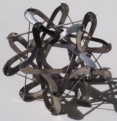 Made of stainless steel this piece intertwines curves and straight lines. Geometric Sculpture, Snake, Stainless Steel, Straight Lines, Curves, Design, Full Figured, Snakes