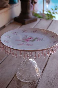 Pretty vintage dessert plate repurposed as a cake stand