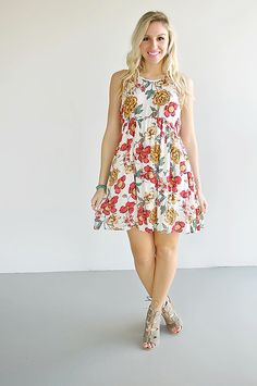 Step into spring with this amazing floral print baby doll dress! It has a girly fit & a trendy back cutout that gives it a little extra flare! Picking out your outfit has never been so easy!