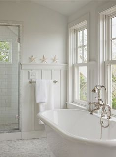 . Bathroom with classic and affordable white subway tiles and marble flooring.