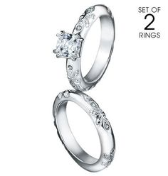 AVON PARADISE BLISS 2-PIECE CZ ENGAGEMENT RING AND BAND SET Silvertone. Set of 2 rings. CZ solitaire and matching band with engraved detail. 1 carat diamond-weight equivalent CZ. GOOD TO KNOW All of Avon-s jewelry is nickel-free for those with sensitive skin & allergies to nickel. $19.99 at Avon - Official Store