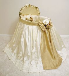 Elegant Gilded Silk Bassinet
