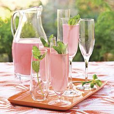 Chic Impression: Pretty in Pink Punch: 1 can frozen pink lemonade concentrate, 4 cups white cranberry juice, 1 quart club soda (could also use ginger ale or sparkling wine), garnish with fresh mint sprigs
