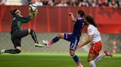 Goalkeeper Gaelle Thalmann of Switzerland fouls Kozue Ando of Japan