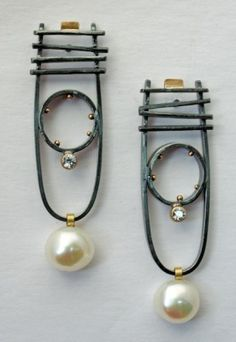 Earrings | Sydney Lynch- love the industrial and the traditional mic, refined and statement