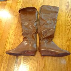 Tan wedge knee high boots Medium brown wedge boots. Top can be turned down. Zipper back. In great condition. Shoes Heeled Boots