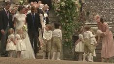 Pippa Middleton and James Matthews exit the church after their wedding ceremony as sister Kate is seen looking after children George and Charlotte.