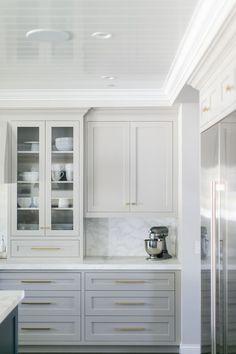 Gorgeous light grey cabinets, marbled countertops & backsplash, white trim & gold hardware. ❤️